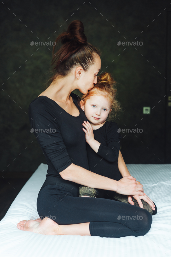 Mom and daughter have fun on the bed - Stock Photo - Images
