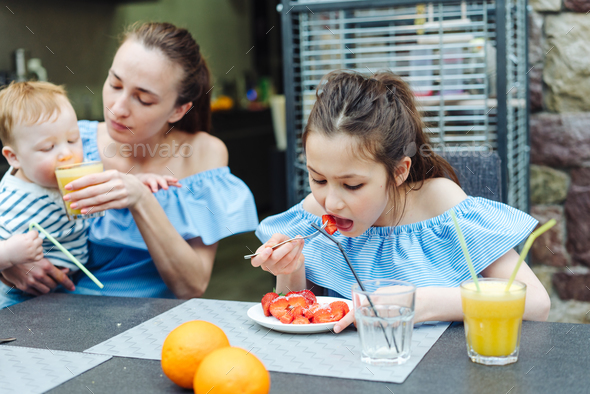 Happy family, fresh fruit breakfast - Stock Photo - Images
