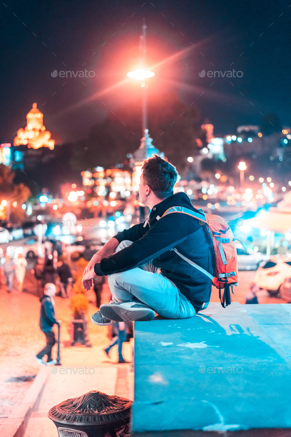 Guy on the background of the Tbilisi. - Stock Photo - Images