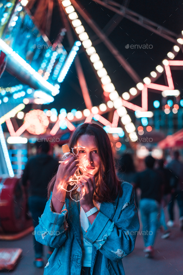 Girl in an amusement park - Stock Photo - Images