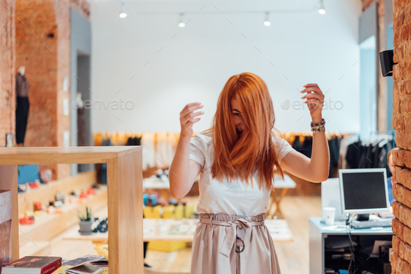 The woman is dancing in the store - Stock Photo - Images