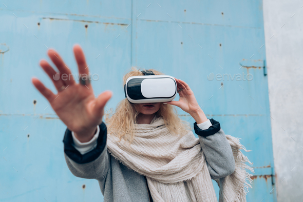 Girl in the street with a vr glasses - Stock Photo - Images