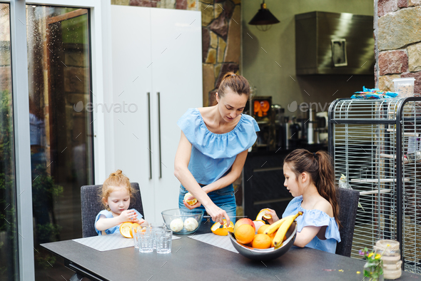 Mom and daughter in the kitchen - Stock Photo - Images