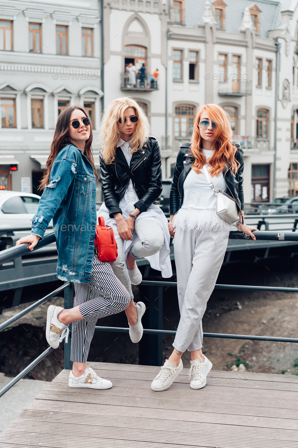 three beautiful girls on the street - Stock Photo - Images