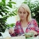 Young Woman Eating at a Cafe on the Summer Ground. The City of Graz in Austria - VideoHive Item for Sale