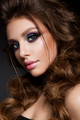 Beautiful young model with bright makeup and sunburn skin Evening make up
