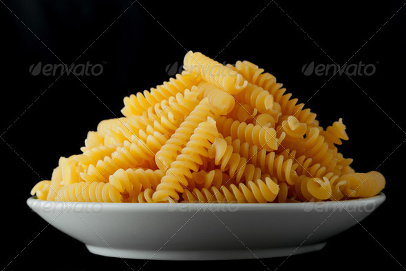 Bowl with raw pasta - Stock Photo - Images