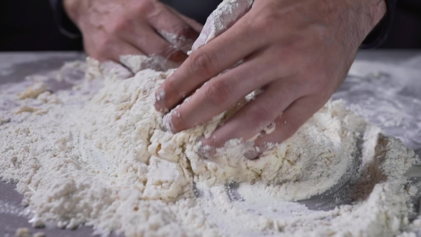 VideoHive The Cook Kneads the Dough Flour and Water Bread and Bakery Baking at the Kitchen Cooking the 20256232
