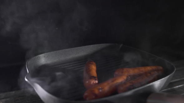 VideoHive Sausages Is Roasting with Smoke on the Hot Grilling Pan Cooking Food Meat Meals Tasty Food Chef 20256239