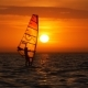 Windsurfing Near Big Sun at Sunrise