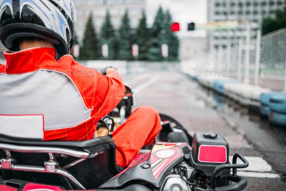 Karting racer, go kart driver in helmet, back view - Stock Photo - Images