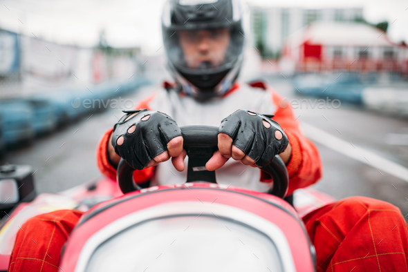 Karting race, go cart driver in helmet - Stock Photo - Images