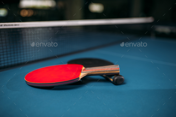 Red and black tennis rackets on table game concept - Stock Photo - Images