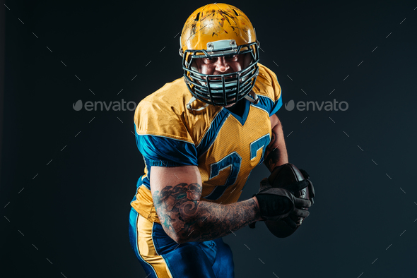American football player, ball in hands, NFL - Stock Photo - Images