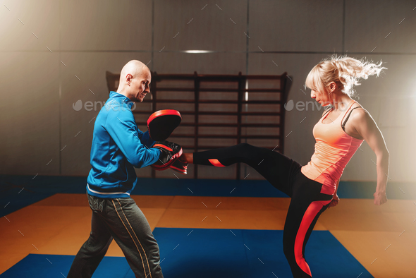 Woman in actoin on self defense workout - Stock Photo - Images