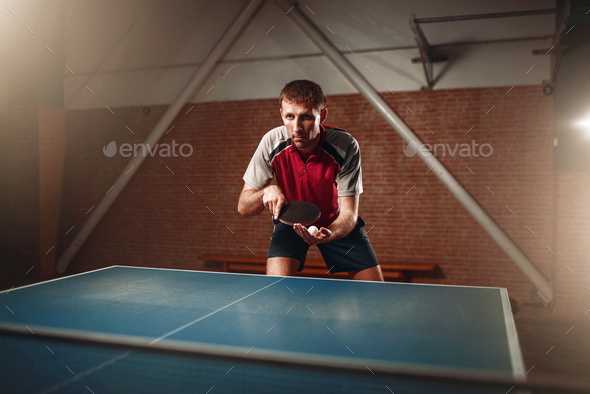 Table tennis, male player with racket and ball - Stock Photo - Images