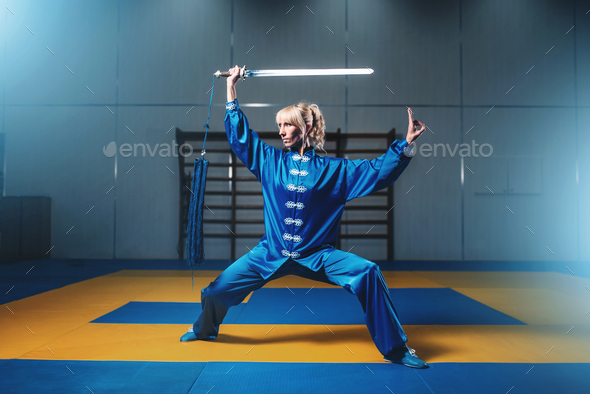 Female wushu fighter with sword in action - Stock Photo - Images