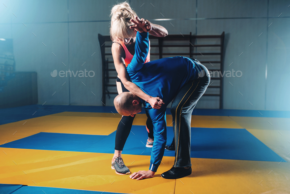 Male and female fighters, self defense technique - Stock Photo - Images