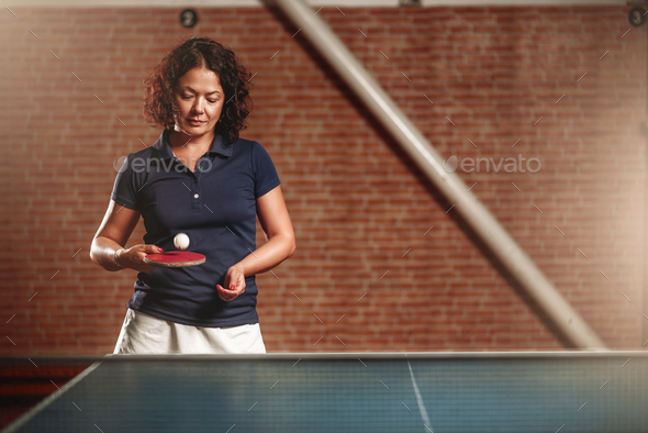 Table tennis, female player with racket hits ball - Stock Photo - Images