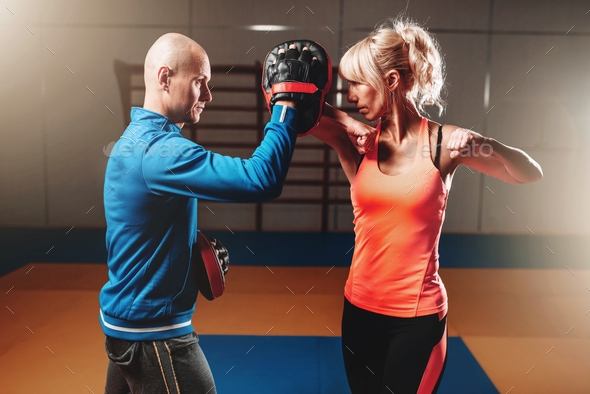 Woman on self defense training with male trainer - Stock Photo - Images
