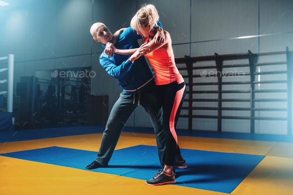 Woman fights with man on self-defense training - Stock Photo - Images