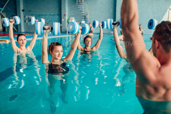 Women aqua aerobics traninig with dumbbells - Stock Photo - Images