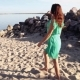 A Beautiful Girl in a Green Dress Is Walking Along the Coast. - VideoHive Item for Sale