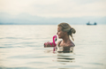 Young woman swimming with flamingo toy, Alanya, Turkey
