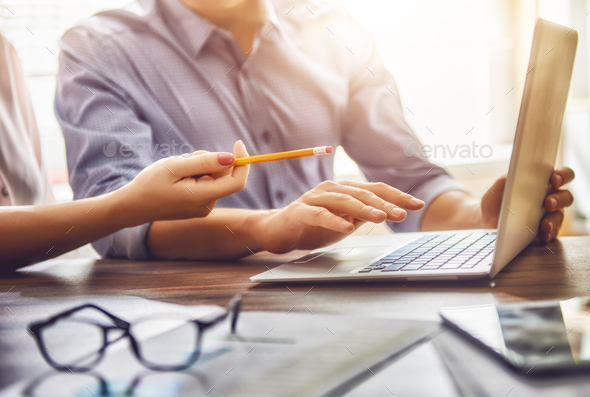 man and woman working in the office - Stock Photo - Images