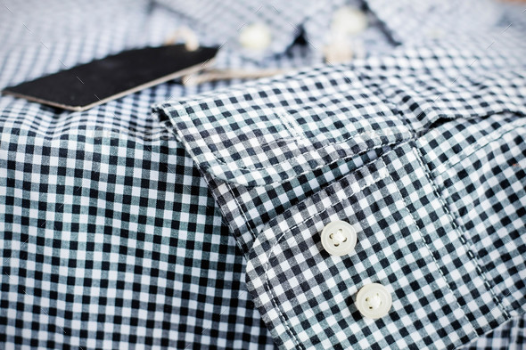 Button and surface of shirt. - Stock Photo - Images