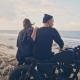 A Young Woman with Her Boyfriend, the Rider and His Motorcycle Admire Together the Wonderful View - VideoHive Item for Sale