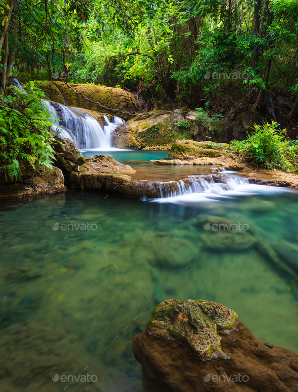 Deep forest Waterfall in Kanchanaburi, Thailand - Stock Photo - Images
