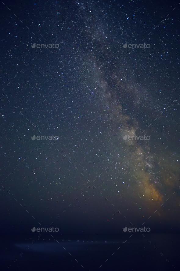 Night sky with stars and sea.