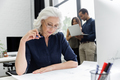 Mature businesswoman working with documents while sitting at her workplace - PhotoDune Item for Sale