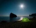 Tent on the beach with rocks and a night sky with stars - PhotoDune Item for Sale