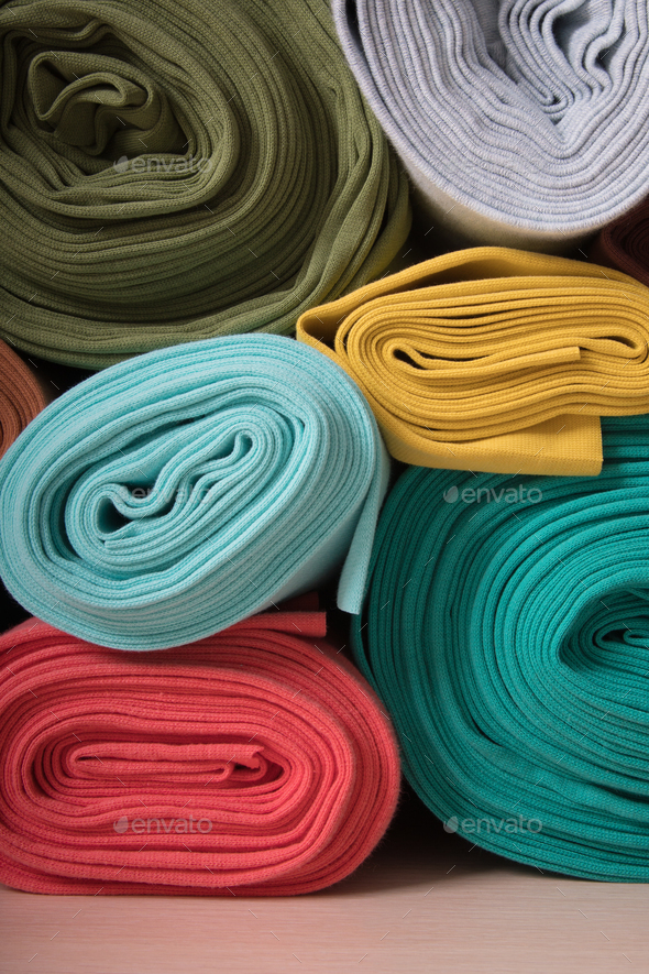 Rolls of knitted fabric in assortment - Stock Photo - Images