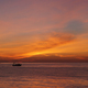 Small fishing boat in the sea at sunset - PhotoDune Item for Sale