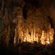 Ice stalagmites in a cave illuminated by candles - PhotoDune Item for Sale