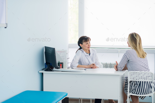 Horizontal view of happy patient at doctor's office - Stock Photo - Images