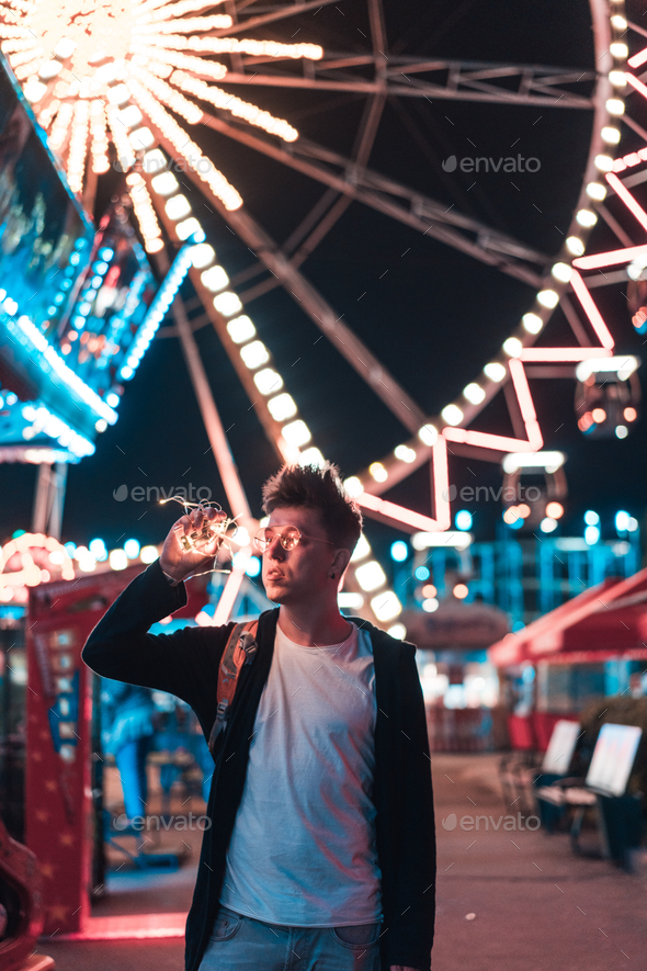 Guy in the amusement park - Stock Photo - Images
