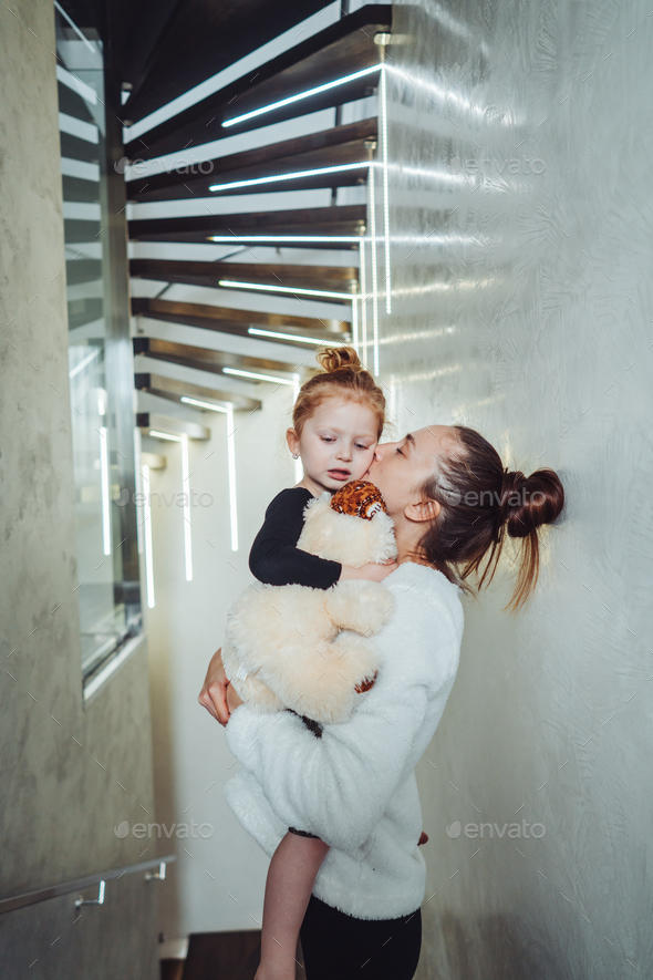 Mom and little daughter in their arms - Stock Photo - Images