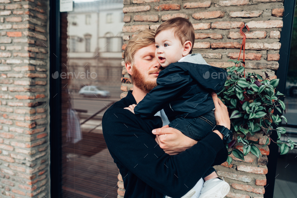 Dad with a small son in his arms - Stock Photo - Images