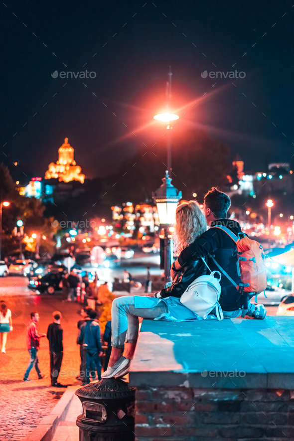 Couple in the background of the Tbilisi. - Stock Photo - Images