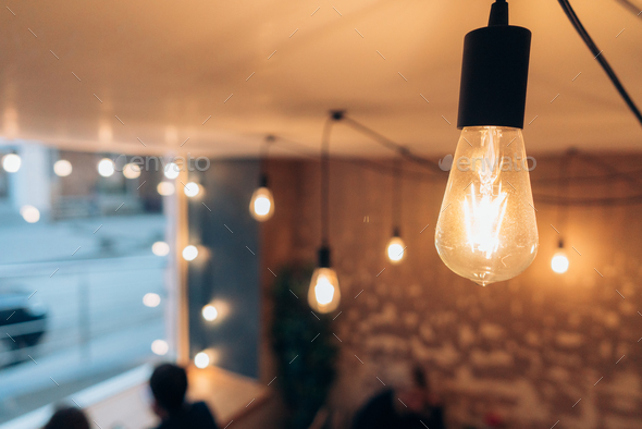 Burning an incandescent edison lamp - Stock Photo - Images