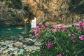 Blooming pink Rhododendron tree in picturesque sea bay, Turkey