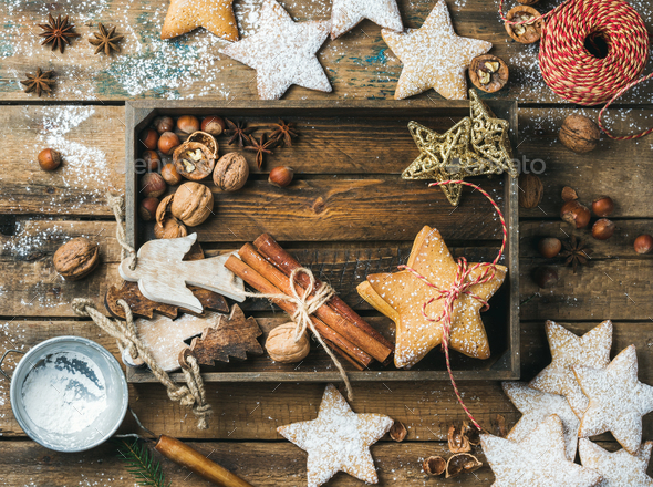 Wooden tray with cookies, decorative angels and stars, cinnamon, nuts - Stock Photo - Images