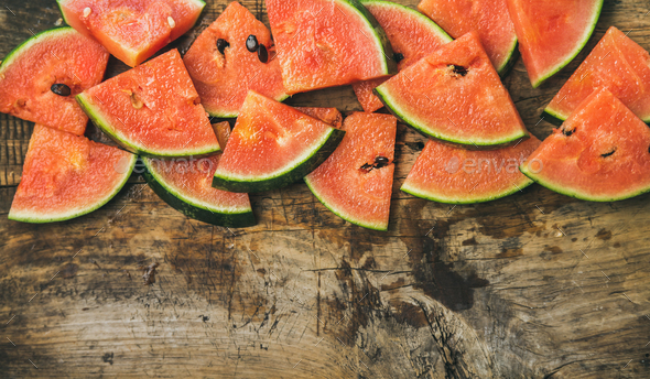 Juicy watermelon pieces over rustic wooden background - Stock Photo - Images