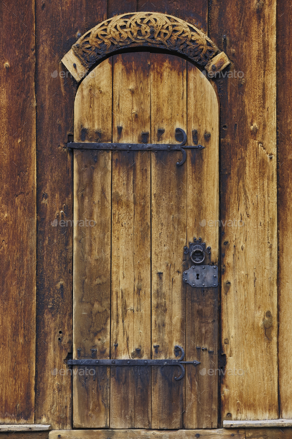 Lom medieval stave church door detail. Viking symbol. Norway tourism  - Stock Photo - Images
