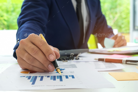 Businessmen are analyzing graph data and taking notes on a flip - Stock Photo - Images