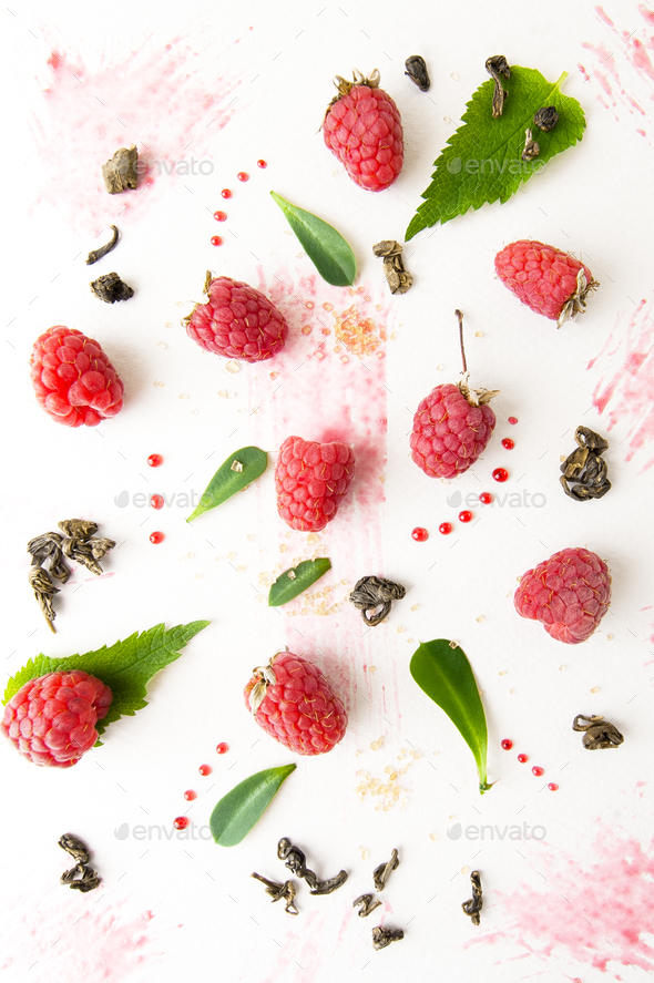 Ripe raspberries, mint leaves, jam and green tea on a white back - Stock Photo - Images